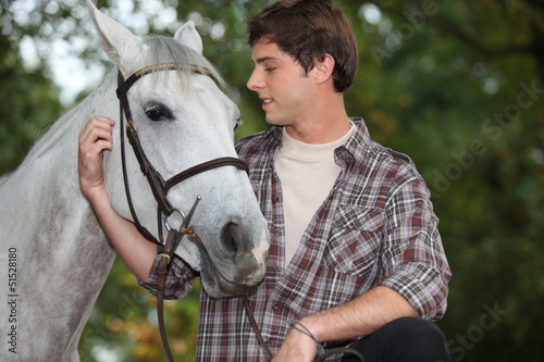 Man looking after horse