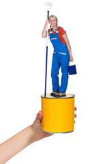 Decorator standing on paint pot