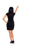 back view of businesswoman pointing up