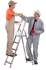 Decorators shaking hands