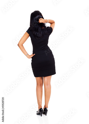 rear view of businesswoman thinking