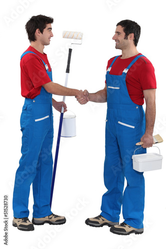 Decorating duo shaking hands