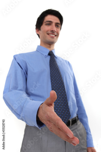 businessman giving his hand for a handshake