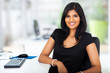 lovely young businesswoman sitting in office