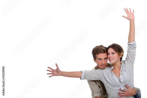 girl with open arms and boyfriend embracing her