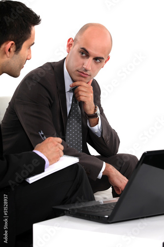 Two businessmen waiting for client