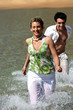 Couple running in the water