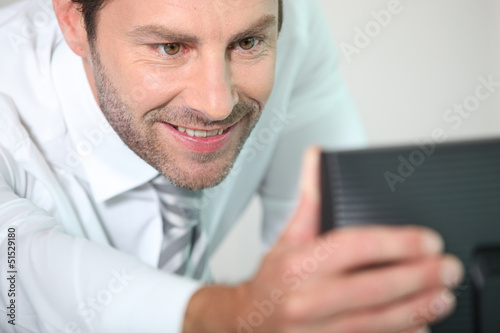 Man adjusting screen