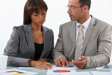 businessman displaying pie chart