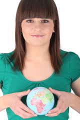 brown-haired girl holding globe