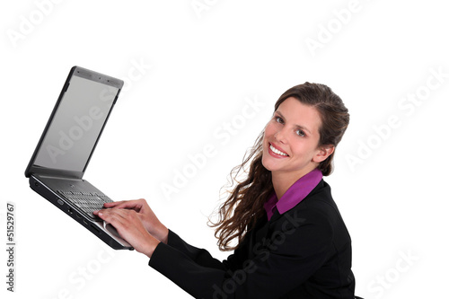 Woman typing on a laptop in mid-air