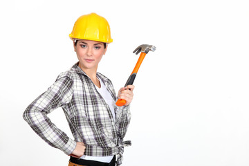 Woman holding a hammer.
