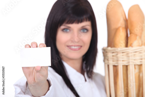 Female baker showing businesscard