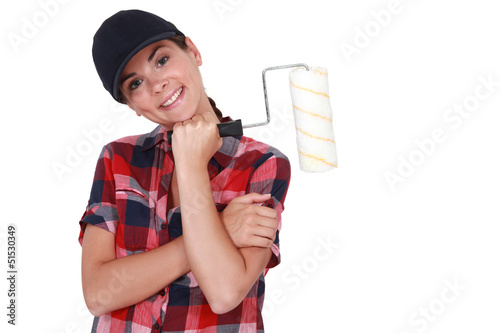 Shy woman holding paint roller