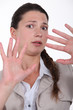 closeup shot of woman expressing refusal with hands