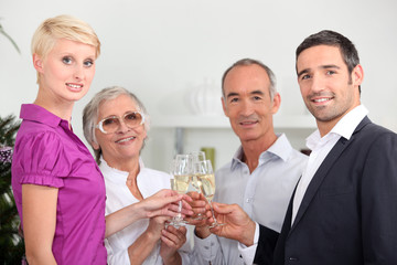 Two couples toasting with champagne