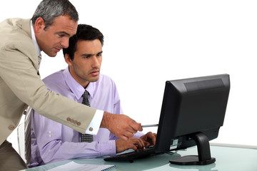Man pointing out an error to his colleague
