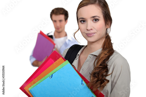 Students carrying folders
