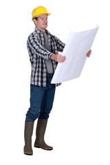 Foreman examining plans