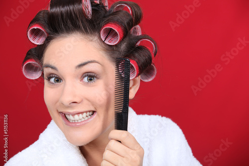 woman wearing curlers on the head