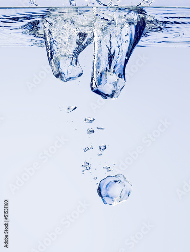 Three Ice Cubes in Water