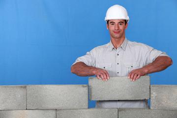 A mason placing a stone