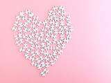 puzzle made heart sharp on pink background