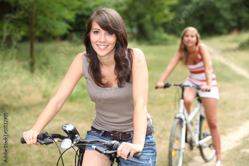 Two girls on bikes
