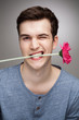 Man with flower in his mouth