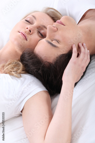 Sleeping couple in bed