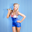 Retro style pin-up sailor girl on blue background