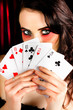 Mysterious female holding deck of playing cards