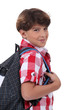 portrait of schoolboy with satchel