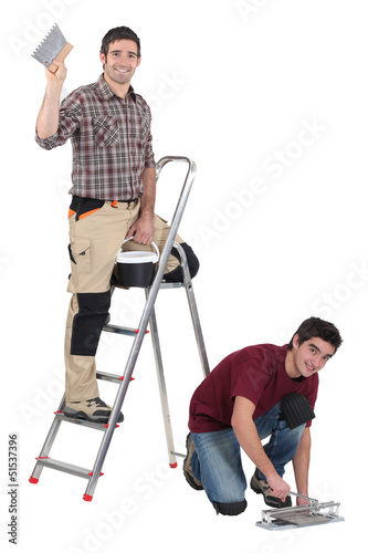 Two decorators working on site