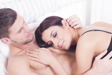 Sexy passionate heterosexual couple in bed