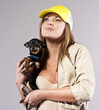 attractive young girl with a dog in studio