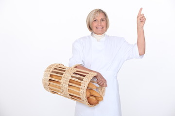 a mature female baker showing something