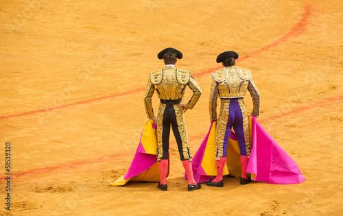 Leinwanddruck Bild Matadors at bullring