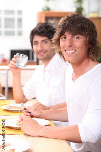 two friends having dinner