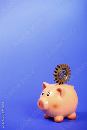 Poster Pig bank holding gear on the back