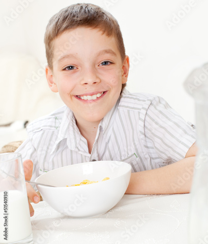 Boy eating frosted flakes
