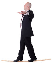 businessman tightrope