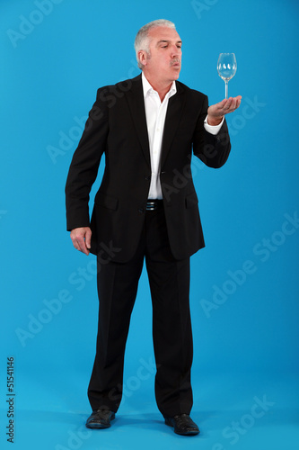 Businessman blowing on  glass