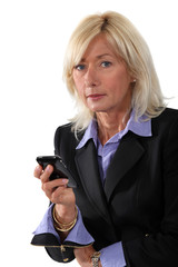 Middle-aged woman with cellphone