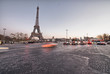 Eiffel Tower with city traffic at sunset - Paris