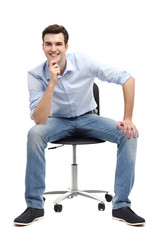 Young man sitting in chair