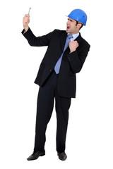 Businessman holding a key