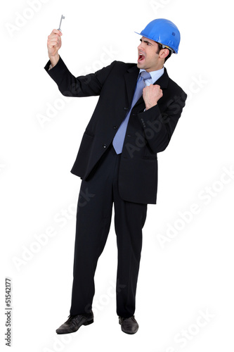Businessman holding a key
