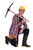 Young worker with a pickaxe