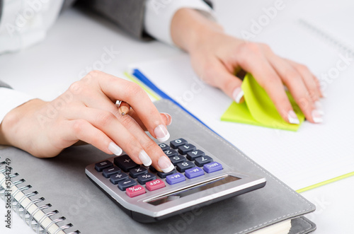 Hands working on the calculator